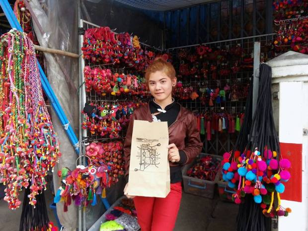 This resident of Chiang Mai, Thailand, filled a bag with colorful puff balls for a project designed to connect members of the community. Photo: TEDxChiangMai